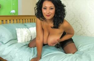 Curvaceous, black-haired milf, Danica..
