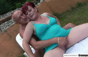 Immense red-haired GILF juggling on a..